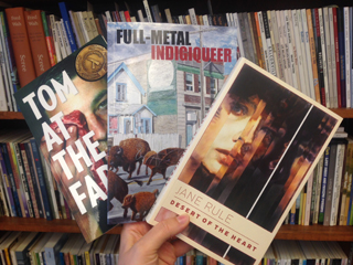 Photo of three books: Tom at the Farm, full-metal indigiqueer, Desert of the Heart