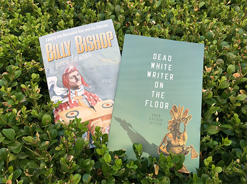 Photo of two books, Billy Bishop and , taken in a parkette