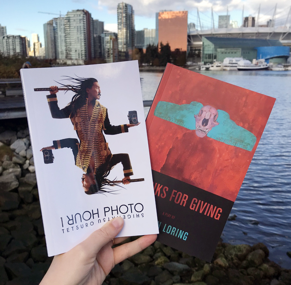 Photo of two books, 1 Hour Photo and Thanks for Giving, at False Creek in Vancouver.