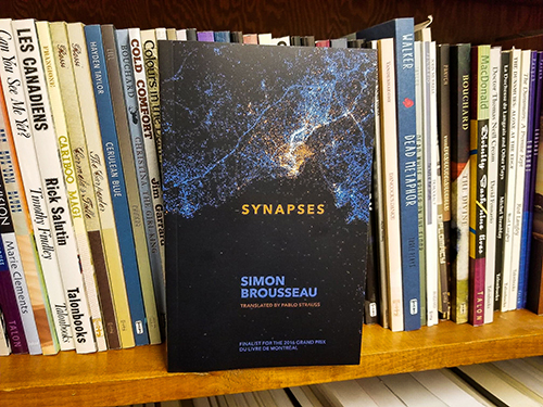 Picture of Synapses leaning against Talonbooks library books.