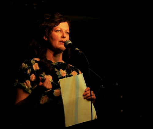 Photo of Jessica Moore reading onstage.